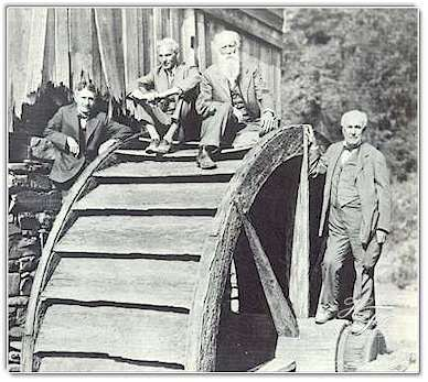 On an ancient waterwheel in West Virginia in 1918, the Four Vagabonds pose for a cameraman. Left to right are Harvey Firestone, Henry Ford, John Burroughs and Thomas A. Edison.