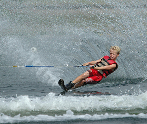 Kid on a water ski.
