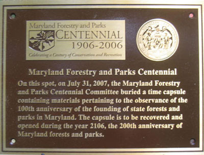 The final Centennial Plaque marking the spot where the Centennial Time Capsule is now buried at Gambrill State Park