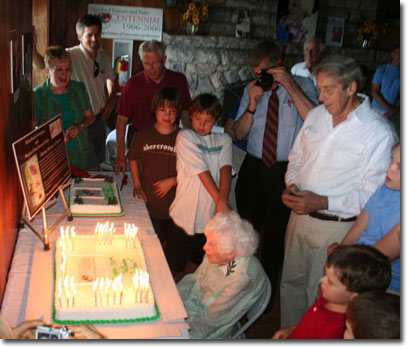 Helen Besley Overington admires 100 lit candles on her birthday cake. Her grandchildren were on hand to help her blow them out.