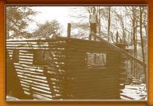 Civilian Convervation Corp worker on roof of cabin at Herrington Manor State Park - 1930's