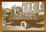 Early educational float on a flat bed truck: If You Want Good Hunting, Obey Game Laws