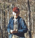 Fred W. Besley working in his forest during his retirement years