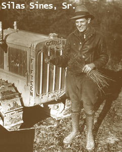 Silas Sines, standing in front of a tractor. Silas was head nurseryman at the state tree nursery from 1929-1974