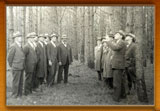 Fred W. Besley and group of men attending a forestry lecture in the field
