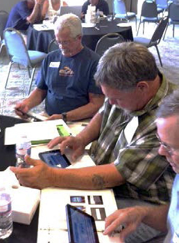 Men sitting at a table during a FACTS training
