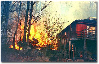 Wildland fire close to a house