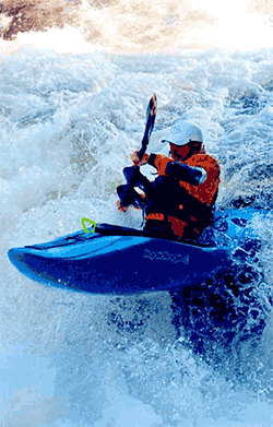 Kayaker in white water with helmet on