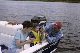 Child with Parents Fishing with a PFD on