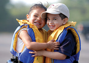 Two children with their life jackets on