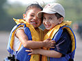 2 young children wearing life jackets