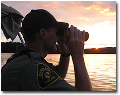 NRP Officer on patrol during sunset