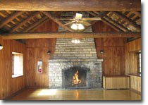 The Team Room features a stone fireplace