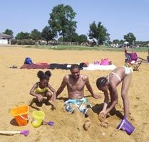 Family On A Beach At Sandy Point