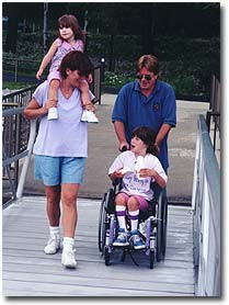 A family on an accessible ramp