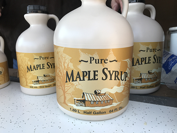Three jugs of maple syrup