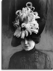Woman in featheresd hat