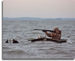Photo of duck hunter in offshore gunning rig zone